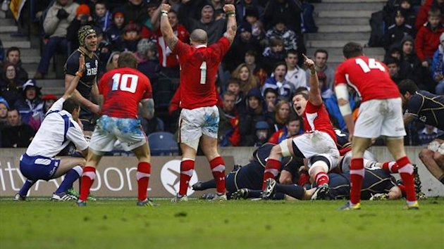 Wales' players celebrate after team mate Richard Hibbard scored a try against Scotland during their Six Nations rugby match at Murrayfield stadium in Edinburgh (Reuters)