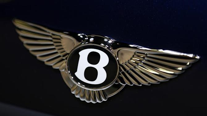 The logo on the back of a Bentley Motors vehicle is seen at the 2013 Los Angeles Auto Show in Los Angeles