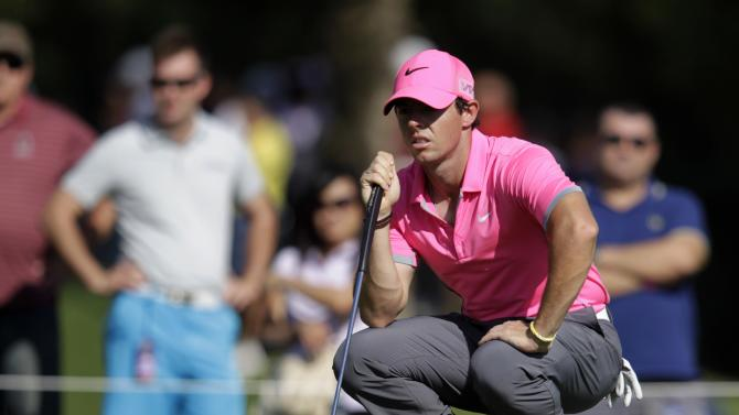 Rory McIlroy of Northern Ireland checks the green on the tenth hole in the second round of the Dubai Desert Classic