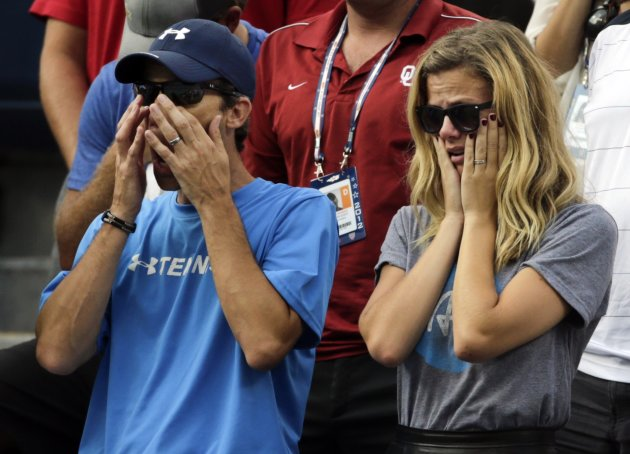 Andy Roddick's wife, Brooklyn Decker, right, reacts after his fourth round loss to Argentina's Juan Martin Del Potro at the  2012 US Open tennis tournament, Wednesday, Sept. 5, 2012, in New York. Rodd
