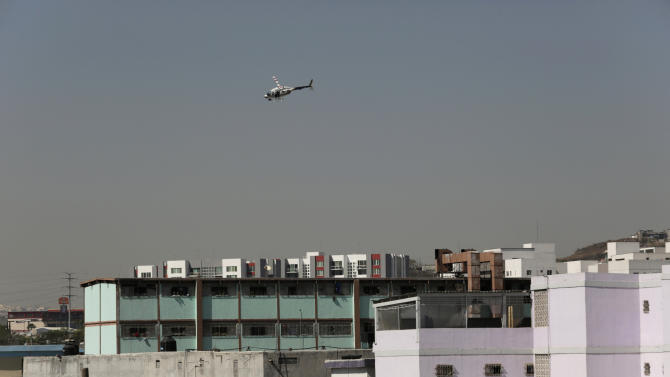A police helicopter flies over the Topo Chico prison in Monterrey
