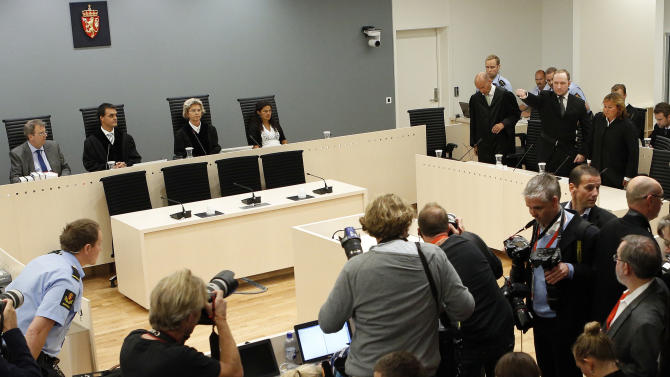 "Confessed mass killer Anders Behring Breivik, top third right, salutes as he arrives in the Oslo court room Friday Aug. 24, 2012 to receive his judgment. Anders Behring Breivik has been declared sane and sentenced to prison for bomb and gun attacks that killed 77 people last year. Reading the ruling, Judge Wenche Elisabeth Arntzen handed down a sentence of ""preventive detention"" of at least 10 years and a maximum of 21 years. However, such sentences can be extended under Norwegian law as long as an inmate is considered dangerous. (AP Photo/Cornelius Poppe / NTB scanpix, Pool)"