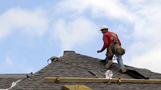 In this Friday, Oct. 12, 2012, photo, a construction worker finishes a roof in Chicago. U.S. sales of new homes fell slightly in October and the September sales pace was slower than initially thought. -The Commerce Department said Wednesday, Nov. 28,2012 that new-home sales dipped 0.3 percent in October to a seasonally adjusted annual rate of 368,000. That's down marginally from the 369,000 pace in September, which was revised lower from an initially reported 389,000. (AP Photo/Nam Y. Huh)
