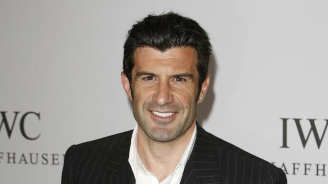 File photo of Portuguese soccer player Figo arriving for the IWC party at the Salon International de la Haute Horlogerie at Palexpo in Geneva
