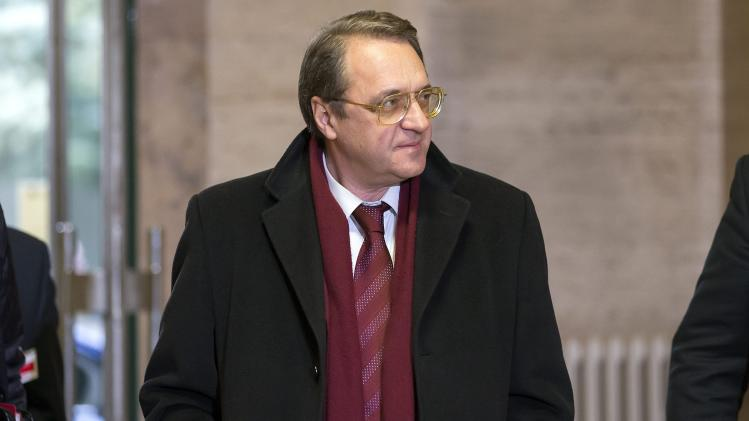 Russian Deputy Foreign Minister Mikhail Bogdanov arrives for a meeting with UN Joint Special Representative for Syria, Lakhdar Brahimi and United States' Deputy Secretary of State William Burns, both unseen, to find a politic solution for the crisis in Syria, at the European headquarters of the United Nations, in Geneva, Switzerland, Friday, Jan. 11, 2013. (AP Photo/Keystone, Salvatore Di Nolfi)
