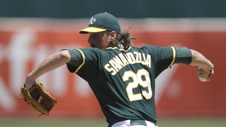 Oakland Athletics' Jeff Samardzija works against the Houston Astros in the first inning of a baseball game Thursday, July 24, 2014, in Oakland, Calif. (AP Photo)