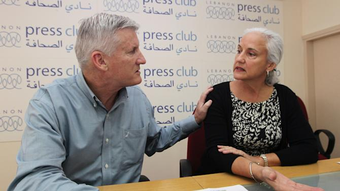 """Marc and Debra Tice, the parents of Austin Tice who is missing in Syria, speak during a press conference, at the Press Club, in Beirut, Lebanon, Monday, Nov. 12, 2012. The family of an American freelance journalist, who disappeared in Syria while covering the war says they still don't know who is holding him. The parents of Austin Tice told reporters in Beirut Monday they have """"no idea where he is and who he is with."""" (AP Photo/Bilal Hussein)"""