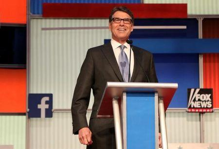Republican presidential candidate Perry waits for the start of a Fox-sponsored forum for lower polling candidates held before the first official Republican presidential candidates debate of the 2016 U.S. presidential campaign in Cleveland