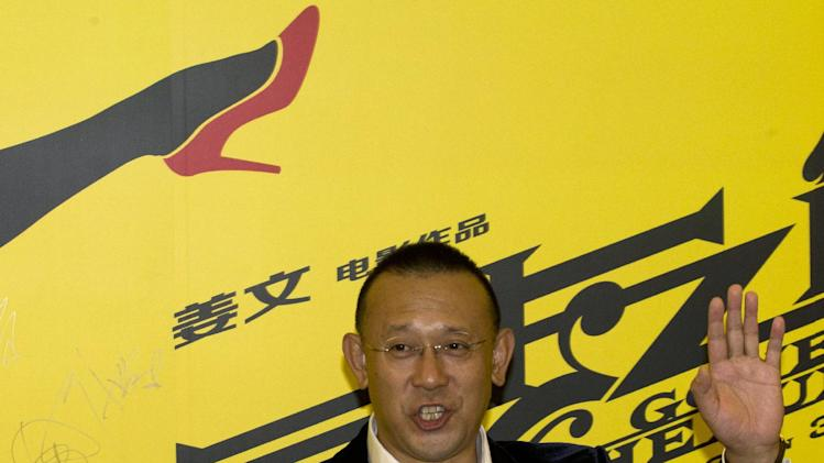 "Chinese director Jiang Wen arrives for a press conference for his new 3D movie ""Gone with the Bullets"" in Beijing, China, Monday, Sept. 1, 2014. Hoping for maximum publicity, Chinese director Jiang Wen launched his latest movie at an event Monday more than three months before it is due to open in cinemas. (AP Photo/Ng Han Guan)"