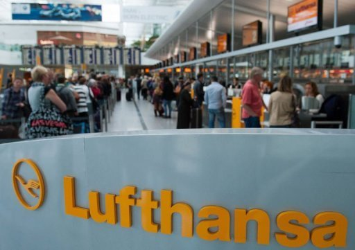 "<p>Flight passengers stand at the Lufthansa check-in at the ""Franz-Josef-Strauss"" airport in Munich, southern Germany, on September 6, 2012. Striking Lufthansa cabin staff said they saw signs of possible movement in their bitter wage dispute as a 24-hour walkout grounded half of the 1,800 flights of Germany's biggest airline.</p>"