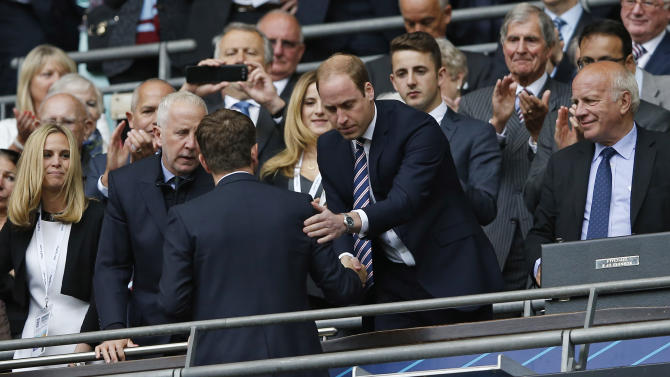 SOC: The Duke of Cambridge, Prince William shakes hands with Aston Villa manager Tim Sherwood after the game as Aston Villa owner Randy Lerner and FA Chairman Greg Dyke look on