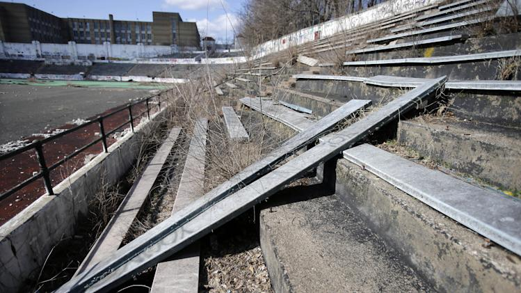 Broken seats are seen in the stands in Hinchliffe Stadium in Paterson, N.J. on Thursday, March 14, 2013. Built as a public works project municipal stadium in 1932, Hinchliffe, listed on the state and National Register of Historic Places, served as home to the New York Black Yankees of the Negro National League from 1933-37 and 1939-45. The once-grand Art Deco stadium earned designation in March as a national landmark - less than two years after the nearby Great Falls, a powerful 77-foot waterfall that helped fuel the Industrial Revolution, became a national park. (AP Photo/Mel Evans)