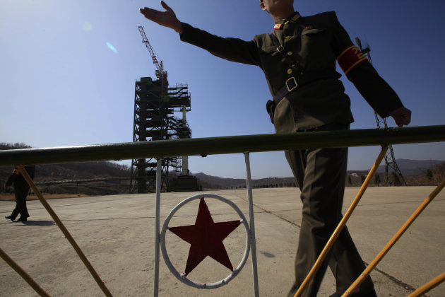 A North Korean soldier stands in front of the country's Unha-3 rocket, slated for liftoff between April 12-16, at Sohae Satellite Station in Tongchang-ri, North Korea on Sunday April 8, 2012. North Ko