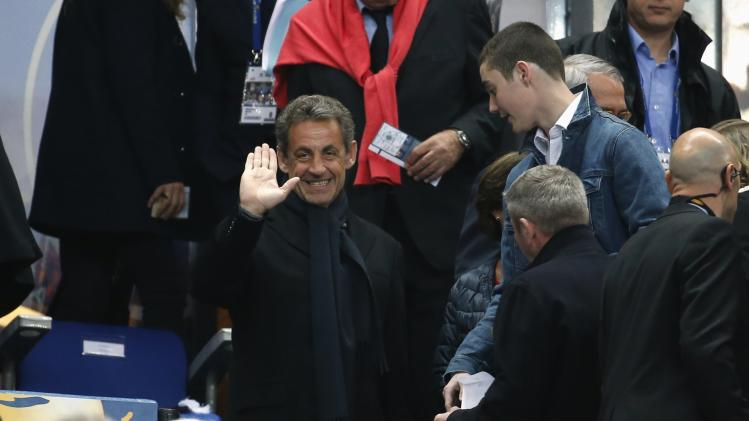 Former French President Nicolas Sarkozy attends the French League Cup final soccer match at the Stade de France stadium in Saint-Denis, near Paris