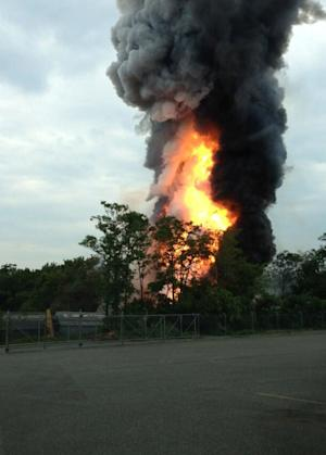 This photo provided by Kevin Lindemann, shows an explosion outside Baltimore on Tuesday, May, 28, 2013. Baltimore County fire officials say a train derailed in a Baltimore suburb on Tuesday and an explosion was heard in the area. A fire spokeswoman says the train derailed about 2 p.m. Tuesday in White Marsh, Md. (AP Photo/Kevin Lindemann)