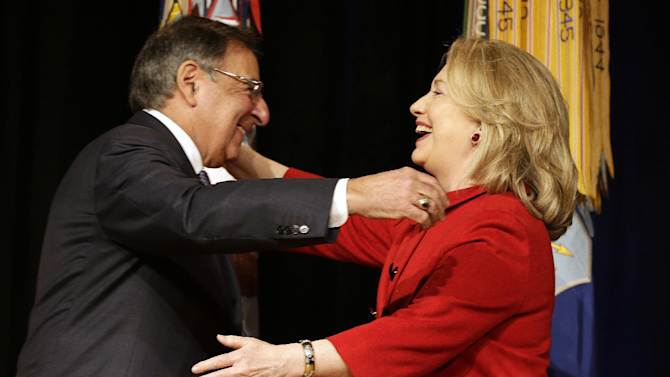 Outgoing Defense Secretary Leon Panetta greets former Secretary of State Hillary Rodham Clinton, during a ceremony at the Pentagon where she was honored, Thursday, Feb. 14, 2013. Panetta presented Clinton with the Defense Department's Medal for Distinguished Public Service. (AP Photo/Jacquelyn Martin)