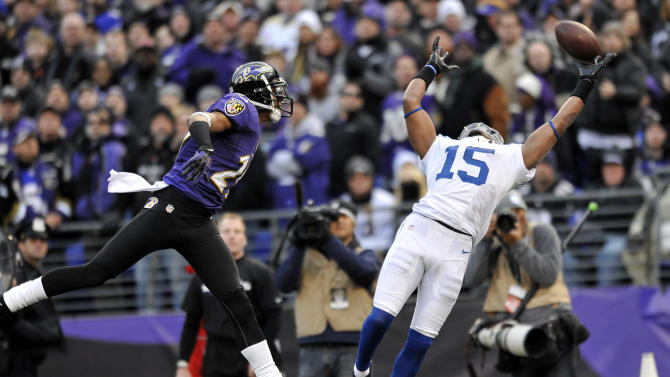 Indianapolis Colts wide receiver LaVon Brazill (15) can't hang onto the pass as Baltimore Ravens cornerback Cary Williams (29) defends, during the second half of an NFL wild card playoff football game Sunday, Jan. 6, 2013, in Baltimore. The Ravens won 24-9. (AP Photo/Gail Burton)