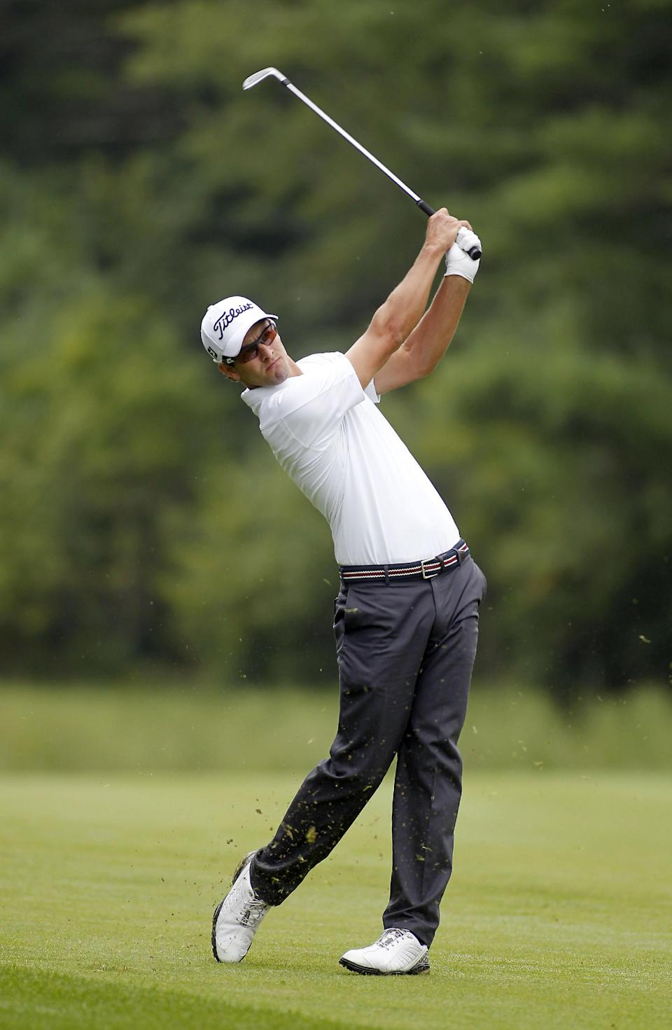 Adam Scott hits his second shot on the 10th hole during the pro-am round of the Deutsche Bank Championships in Norton, Mass., Thursday, Aug. 29, 2013. (AP Photo/Stew Milne)