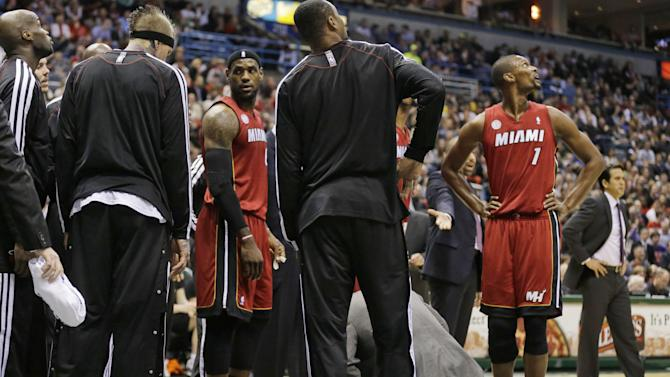 CORRECTS SPELLING TO DWYANE, INSTEAD OF DWAYNE - Miami Heat's Dwyane Wade lies on the court during the first half against the Milwaukee Bucks in an NBA basketball game Friday, March 15, 2013, in Milwaukee. (AP Photo/Jeffrey Phelps)
