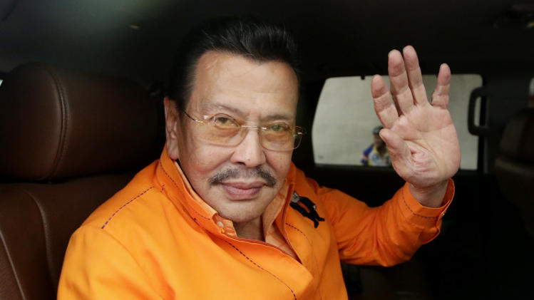 """Former Philippine President and now Mayor-elect Joseph """"Erap"""" Estrada waves from his SUV shortly after his proclamation by the City Board of Canvassers of the Commission Elections Tuesday May 14, 2013, a day after the country's automated midterm elections in Manila.  Former President Estrada was proclaimed Tuesday as the new mayor of the Philippine capital, his first elected post since he was ousted in an anti-corruption revolt 12 years ago. (AP Photo/Bullit Marquez)"""
