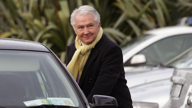This photo of Dec. 10, 2011 shows former chairman of Anglo-Irish Bank Sean FitzPatrick in Dublin Ireland who has been arrested by fraud squad officers investigating financial irregularities. Irish police say fraud detectives have arrested the former chief executive of Anglo Irish Bank and charged him over a conspiracy to hide losses at the bank before its 2009 nationalization. Sean FitzPatrick was arrested Tuesday July 24, 2012 at Dublin Airport as he returned from a family holiday.  (AP Photo/Niall Carson/PA Wire)  UNITED KINGDOM OUT