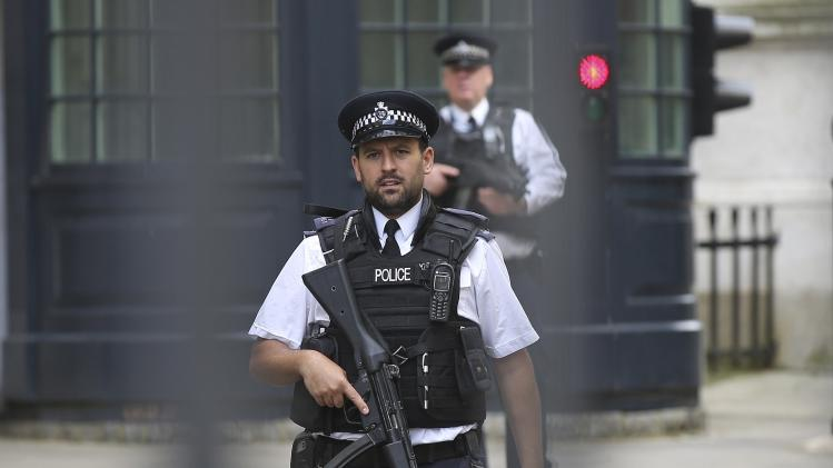 Armed police officers are seen on duty in Downing Street, central London