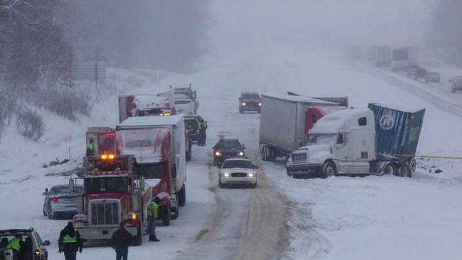 This photo provided by the Michigan State Police shows the scene of a multiple vehicle crash, Thursday, Jan. 31, 2013 in Paw Paw, Mich. In southwest Michigan, eight tractor-trailers and six cars crashed on I-94, closing the westbound lanes to traffic at Paw Paw in Van Buren County. (AP Photo/Michigan State Police)