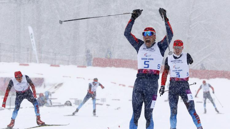 Russia's Mikhaylov celebrates his gold medal during the men's 1 km sprint cross-country standing at the 2014 Sochi Paralympic Winter Games in Rosa Khutor