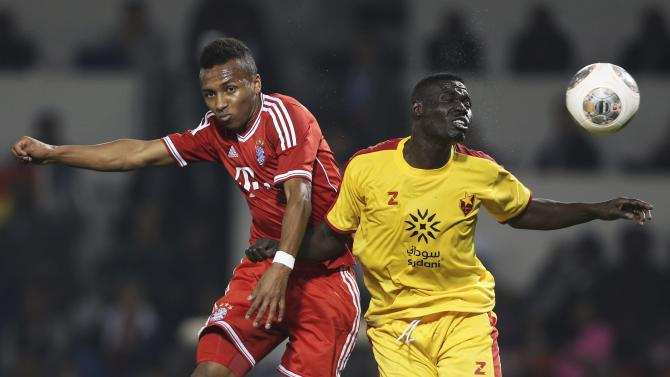 Bayern Munich's Julian Green fights for the ball with Al-Merrikh's Ramadan Ajab during their friendly soccer match in Doha