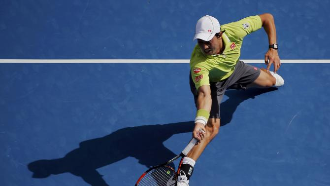 Nishikori of Japan hits a return to Ferrer of Spain during their men's singles fourth round match at the Australian Open 2015 tennis tournament in Melbourne