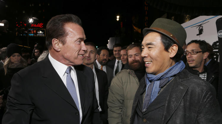 """Arnold Schwarzenegger and Director Jee-woon Kim attend the LA premiere of """"The Last Stand"""" at Grauman's Chinese Theatre on Monday, Jan. 14, 2013, in Los Angeles. (Photo by Todd Williamson/Invision/AP)"""