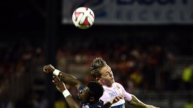Paris Saint-Germain's French defender Serge Aurier (L) heads the ball with Evian TG's Danish forward Nicki Nielsen during the match between Evian Thonon Gaillard and Paris Saint-Germain in Annecy, France, on August 22, 2014