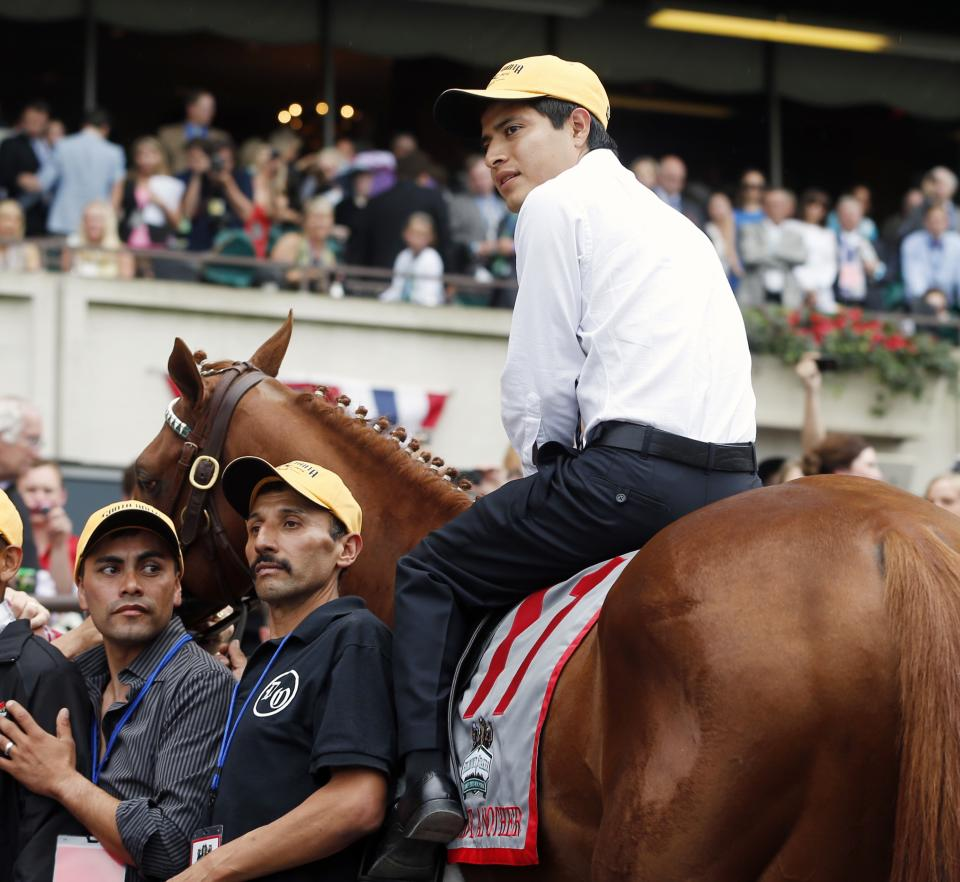 Jockey Mario Gutierrez sits atop I'll Have Another during a retirement ceremony in the winner's circle at Belmont Park in Elmont, N.Y., Saturday, June 9, 2012. (AP Photo/Mike Groll)