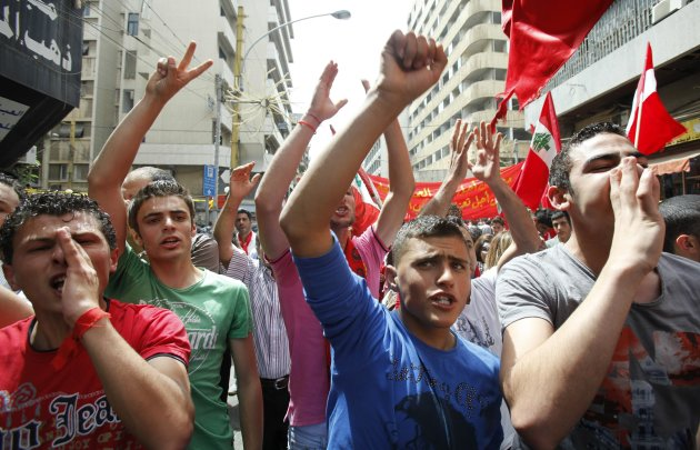 Lebanese leftist activists take part in a demonstration to mark Labour Day, or May Day, in Beirut