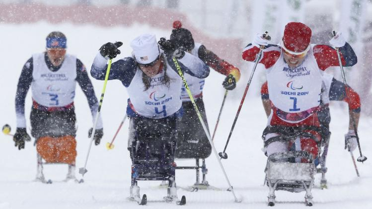 Norway's Martinssen, Mcfadden of U.S and Masters ski during women's 1 km sprint cross-country sitting final at 2014 Sochi Paralympic Winter Games in Rosa Khutor