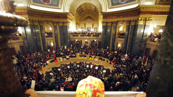 The state Capitol in Madison, Wis., has been reoccupied by protesters who rushed into the building after hours, Wednesday evening, March 9, 2011. The Wisconsin Senate voted Wednesday night to strip nearly all collective bargaining rights from public workers, approving an explosive proposal that had rocked the state and unions nationwide after Republicans discovered a way to bypass the chamber's missing Democrats. (AP Photo/Wisconsin State Journal, M.P. King)