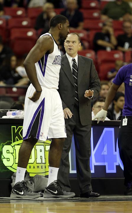 Sacramento Kings head coach Michael Malone talks with Kings forward Patrick Patterson during the first quarter against the Los Angeles Clippers in a NBA preseason basketball game in Sacramento, Calif.