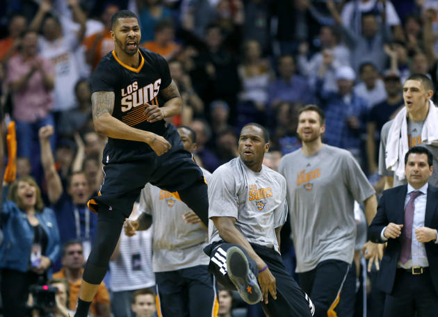 Phoenix Suns' Markieff Morris (11) celebrates against the Oklahoma City Thunder during the second half of an NBA basketball game, Thursday, March 6, 2014, in Phoenix. The Suns won 128-122. (AP Pho