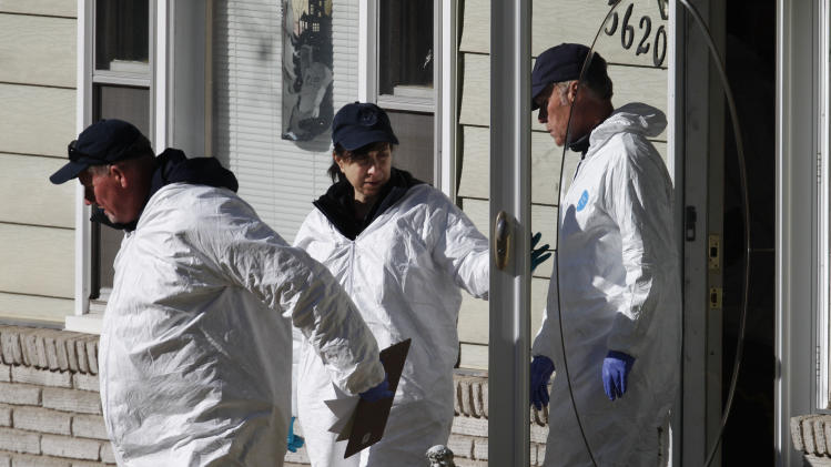Investigators leave the home of missing baby Lisa Irwin in Kansas City, Mo., Wednesday, Oct. 19, 2011. (AP Photo/Orlin Wagner)
