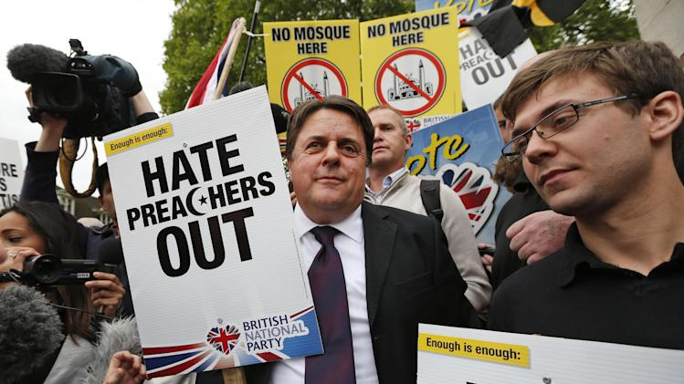 British National Party (BNP) leader Nick Griffin, centre, talks to his supporters during a demonstration in central London, Saturday, Jun. 1, 2013. British National Party supporters gathered to protest the May 22 killing of British soldier Lee Rigby. (AP Photo/Lefteris Pitarakis)