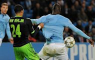 Mario Balotelli (right) is pulled back in the penalty area by Ricardo van Rhijn during the Champions League match between Manchester City and Ajax at The Etihad Stadium last week