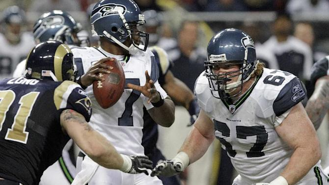 Seattle Seahawks guard Paul McQuistan (67) defends the Seattle Seahawks quarterback Tarvaris Jackson (7) during the third quarter of an NFL football game Sunday, Nov. 20, 2011, in St. Louis