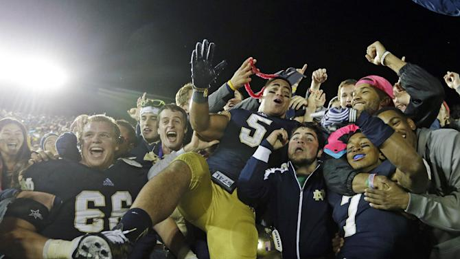 Sept. 22, 2012 photo, Notre Dame's Chris Watt (66), Manti Te'o (5) and TJ Jones (7) celebrate with fans after Notre Dame defeated Michigan, 13-6,  in an NCAA college football game in South Bend, Ind. Notre Dame defensive coordinator Bob Diaco believes Manti Te'o is the finest football player in college. (AP Photo/Darron Cummings)