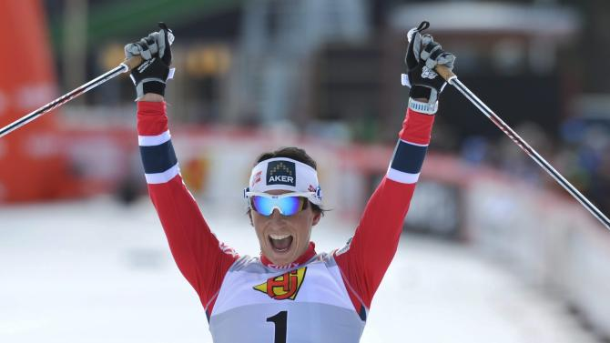 Norway's Marit Bjorgen reacts after crossing the finish line as winner of the women's 10km pursuit during the FIS Cross-Country World Cup Final in Falun, Sweden, Sunday March 24, 2013. (AP Photo / ANDERS WIKLUND,  SCANPIX)   SWEDEN OUT