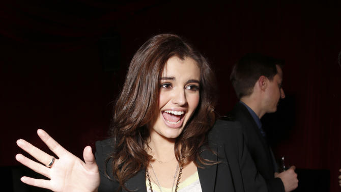 Rebecca Black dances at a Celebration of LA's Music Industry at the Getty House on Thursday, Feb. 7, 2013 in Los Angeles. (Photo by Todd Williamson/Invision/AP)
