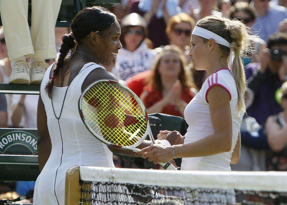Serena Williams, left, of the US is congratulated by Russia's Maria Kirilenko after their match at the All England Lawn Tennis Championships at Wimbledon, Saturday, June 25, 2011. (AP Photo/Alastair Grant)