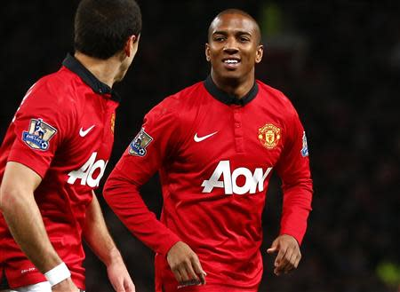 Manchester United's Ashley Young celebrates with team mate Javier Hernandez after scoring a goal against West Ham during their Premier League match in Manchester