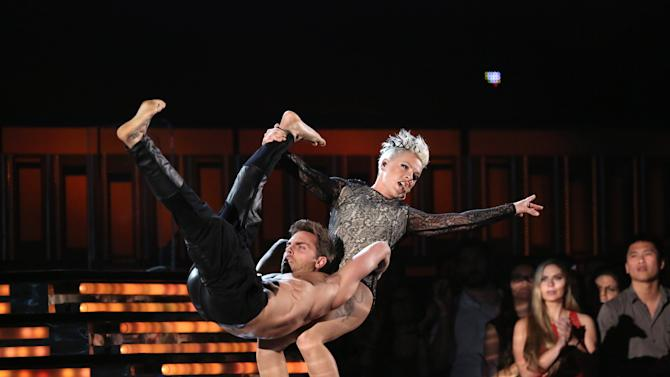"Pink performs ""Just Give Me a Reason"" on stage at the 56th annual Grammy Awards at Staples Center on Sunday, Jan. 26, 2014, in Los Angeles. (Photo by Matt Sayles/Invision/AP)"