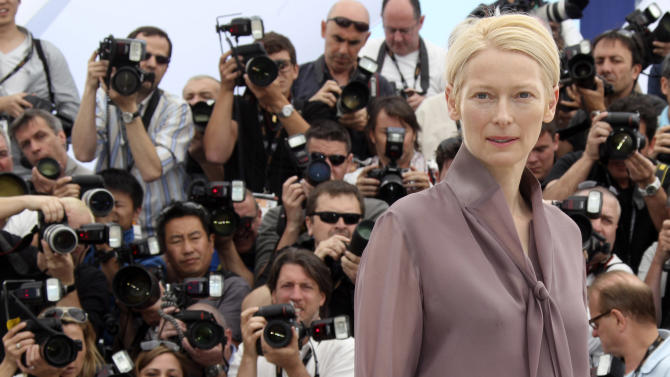 """FILE - In this May 16, 2012,  file photo, actress Tilda Swinton poses during a photo call for Moonrise Kingdom at the 65th international film festival, in Cannes, southern France. Actress Tilda Swinton is performing the art of sleeping at New York City's Museum of Modern Art. A museum spokeswoman says the """"Moonrise Kingdom"""" star presented her one-person piece called """"The Maybe"""" on Saturday, March 23, 2013. (AP Photo/Joel Ryan, File)"""