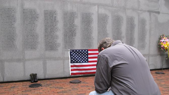 """Former Marine Ed Ayers of Scranton, Penn., hangs his head and weeps at the Beirut Bombing Memorial in Jacksonville, N.C., on Wednesday, Oct. 23, 2013. Wednesday was the 30th anniversary of the terrorist bombing at a Beirut Marine barracks3 that killed 241 U.S. service members. Ayers, who did two tours in Lebanon, said the peacekeeping mission there was worth it but, """"I wish it was handled differently."""" (AP Photo/Allen G. Breed)"""